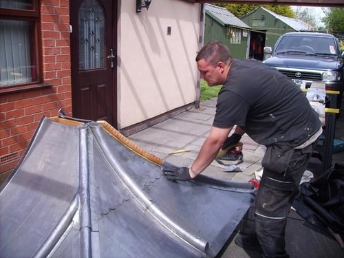 Image of preparing lead before fitting to roof